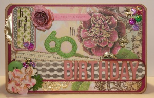 A mixture of papers, glitter, thickers, flowers made this card really sparkle